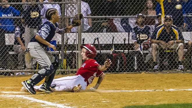 Holbrook's Tai Mann (21) is safe at home with a run in the bottom of the 5th at the game 2 of the NJ State Little League Tournament at Kittatinny Little League 1 in Newton, July 27, 2017. (Photo by Warren Westura for the Asbury Park Press)
