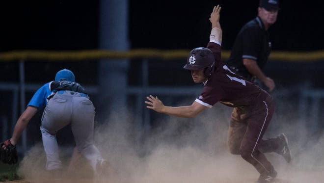 Henderson County's Nick Wimber (19) scurries to home plate as the ball is over thrown at third base during the district baseball final at Webster County High School on Thursday, May 24, 2018. Henderson County defeated Union County 11-0 in five innings.