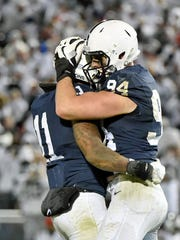 Penn State's Brandon Bell and Evan Schwan embrace in the second half of an NCAA Division I college football game Saturday, Oct. 22, 2016, in Beaver Stadium. Penn State defeated Ohio State 24-21.