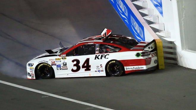 David Ragan's car clips a SAFER barrier during a Budweiser Duel race at Daytona International Speedway on Thursday.