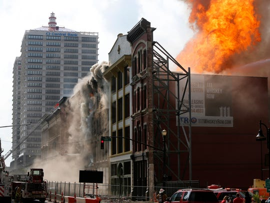 When I arrived at the fire on Whiskey Row, Main Street Louisville, I knew that the age of the wood in the historic buildings could result in a massive fire.  The Louisville Fire Department did a masterful job in saving the historic cast iron building exteriors. By Pat McDonogh, The Courier-Journal. July 6, 2015.