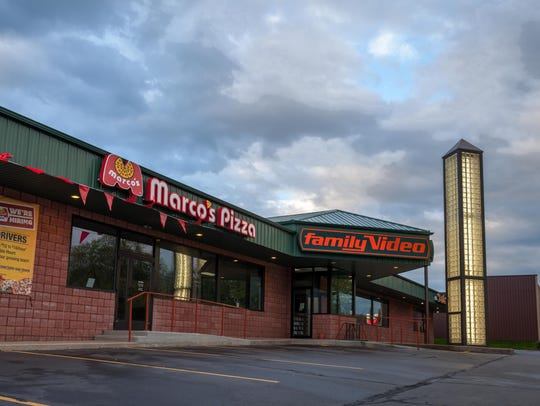 Exterior of Marco's Pizza and Family Video located
