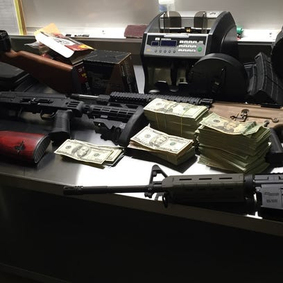 Drugs, guns and money were seized in a Shelby County