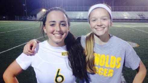 Reynolds' Karissa Grooms, left, and Megan McCallister.