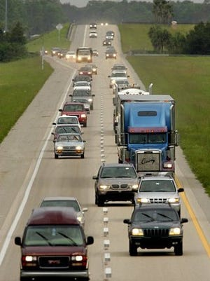 Vehicles head northbound on I-75 just north of Bonita Springs Road on Oct. 21, 2005. Lee and Collier County Emergency Management issued mandatory evacuations over the past two days which has increased traffic on I-75.