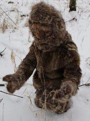 Gawain MacGregor prays in an animal skin suit, created