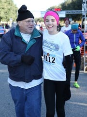 Ray Hanlon with runner Ana Wallace.