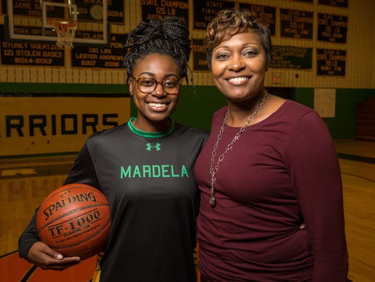 Kayla Cook, a senior guard at Mardela high school, poses for a photo with her mother, Mardela girls basketball coach Kesha on Thursday, Dec. 14, 2017.