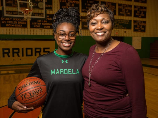 Kayla Cook, a senior guard at Mardela high school, poses for a photo with her mother Mardela girls basketball coach Kesha on Thursday, Dec. 14, 2017.