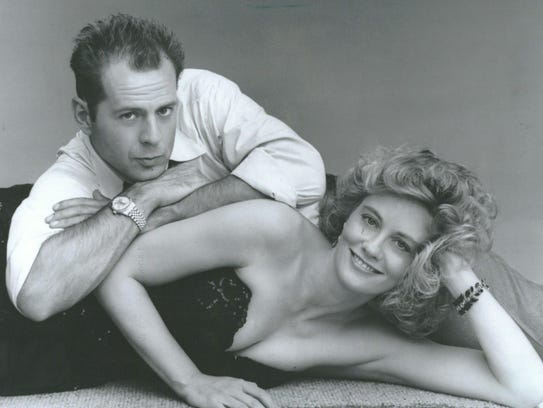 "Bruce Willis and Cybil Shepherd in ""Moonlighting."""