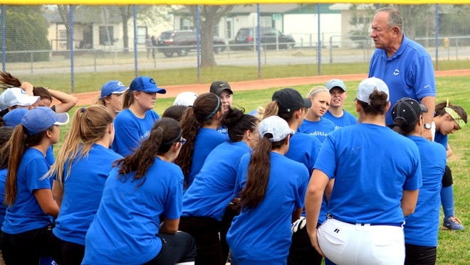 Carlsbad listens to coach John Tigert discuss Tuesday's hitting drills at the start of practice. The Cavegirls will play in the Artesia Invitational on Friday and Saturday.
