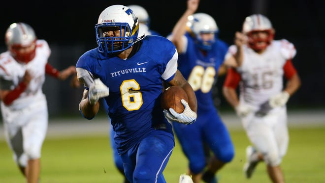 Titusville's Jaleel Davis breaks into the open field during Friday's game against Satellite.