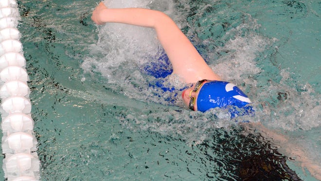 Carlsbad's Aryn White competes in the girls 50-yard freestyle during the district championships Saturday at Hobbs.