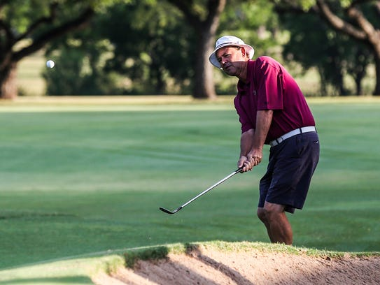 Rick Houston hits a shot on the fairway during the