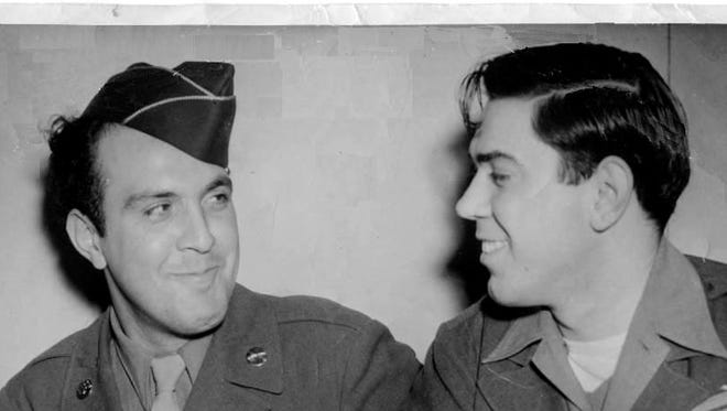 Ernie Sardo, (r) and his brother John share a moment in this photograph. Both men were members of the U.S. Army during World War II.