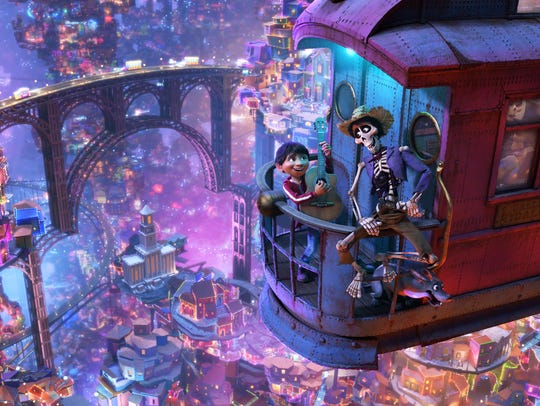 Miguel (voiced by Anthony Gonzalez, left) teams up