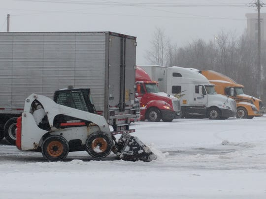 A front loader keeps the snow cleared at Tom's at the intersection of I-83 and Route 851 near Shrewsbury. Trucks were moving in and out of the truck stop.