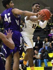 Jared Session, right, attempts a layup while being guarded by Cory Knight on Friday night.