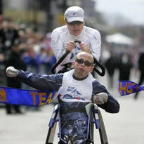 Dick and Rick Hoyt, shown competing in 2011 Boston Marathon,  have competed in over 1100 athletic events in the last 37-plus years and have received world-wide acclaim. They will be guest speakers at the Cox Pensacola Sports Banquet on March 16