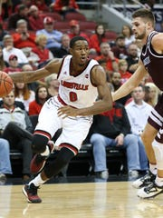 U of L's V.J. King (0) drives against Bellarmine during