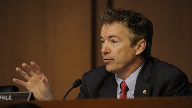 Sen. Rand Paul questions then-Secretary of State Hillary Clinton at a 2013 Capitol Hill hearing about the 2012 Benghazi attacks.