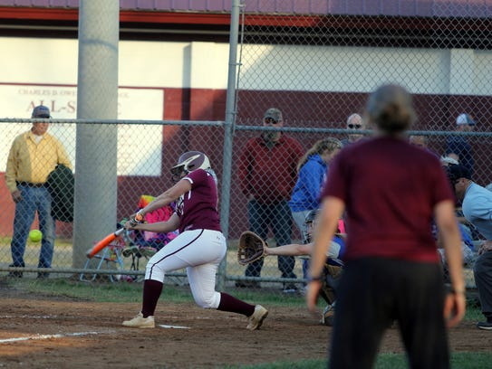 Senior Natalie Stewart swings at a pitch against Polk