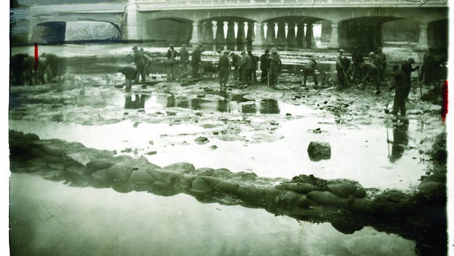 This photo depicts workers building dams in the River Raisin, circa 1930s.