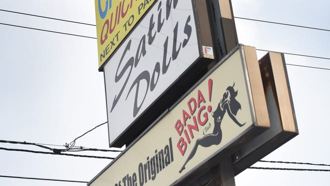 Exterior and the sign of Satin Dolls, the real-life club that inspired the Bada-Bing! of Sopranos fame. The club lost its liquor license and was ordered closed by the state attorney general after its owner, Anthony Cardinalle, pleaded guilty to racketeering and conspiracy charges.