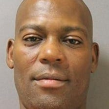 Arrest photo of Desmond Brownlee, 45, of Deltona, Fla., who was charged with choking his wife during an altercation over fried chicken.