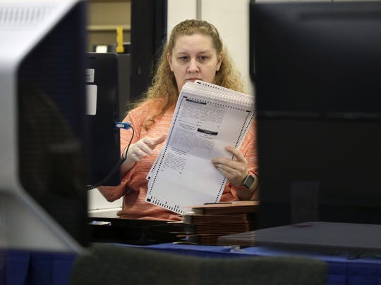 A Clark County election employee works on a recount of presidential election ballots Monday, Dec. 5, 2016, in North Las Vegas.