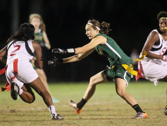 Lincoln's Mallory Eichin goes for a flag pull on Florida