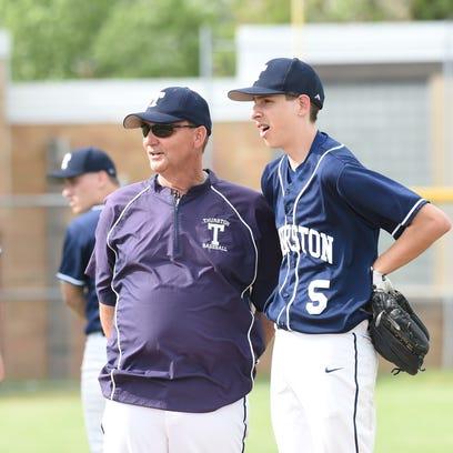 Redford Thurston baseball coach Bob Snell talks to