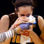 Iowa center Bethany Doolittle is helped from the floor after being fouled by Baylor's Sune Agbuke during the second half of an NCAA women's college basketball regional semifinal game in the NCAA Tournament, Friday, March 27, 2015, in Oklahoma City.