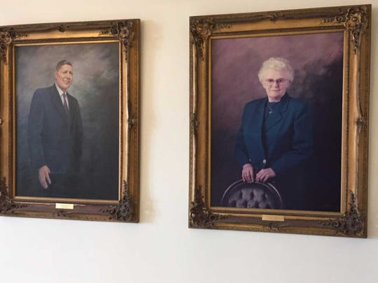 Thelma Conner's portrait hangs next to that of her husband, Milton, at the Dunes Manor Hotel.