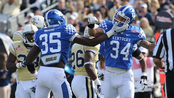 Kentucky players Jordan Jones and Denzil Ware celebrate after a tackle by Jones in the first half.December 31, 2016