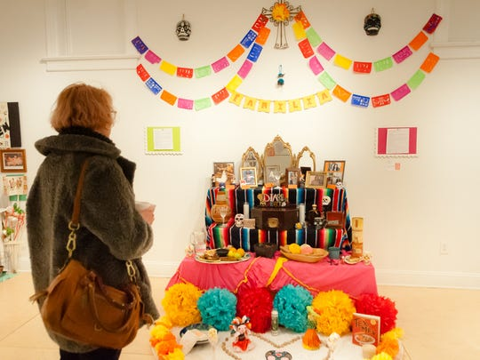 Colorful ofrendas honor those who died in the previous year as part of Dia de los Muertos celebrations.