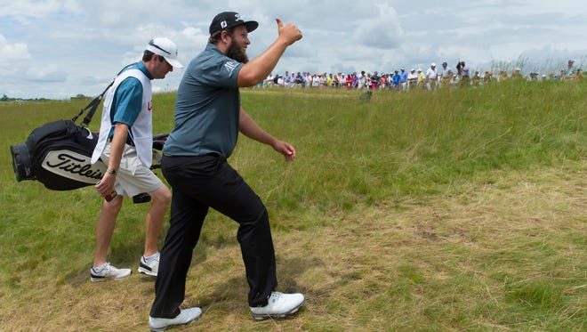 "Andrew Johnston responds to cheers of ""Beef"" while walking to the first tee during the third round of the U.S. Open golf tournament at Erin Hills."
