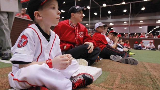 J.J. Brutvan was in full baseball gear waiting for his turn at batting practice during 2013's festivities at Redsfest.