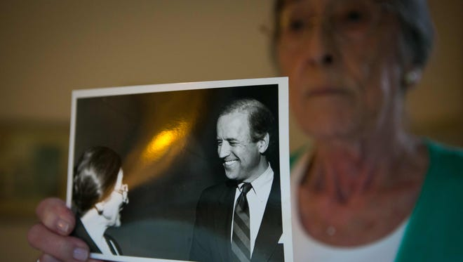 Biden family friend and campaign volunteer Sonia Sloan holds up a picture of her and Joe Biden in the 1990s. The vice president is scheduled to address the Democratic National Convention on Wednesday.