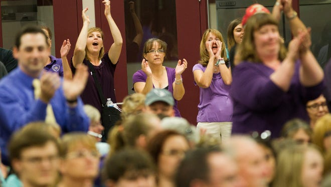 Gilbert Classical Academy supporters cheer during a governing board meeting in 2012. Under the new rules, cheering is frowned upon and comments are limited to a half-hour per meeting.