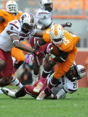 Tennessee Volunteers running back Marlin Lane (15) is tackled by South Carolina Gamecocks linebacker Marcquis Roberts (21) during the second quarter at Neyland Stadium.