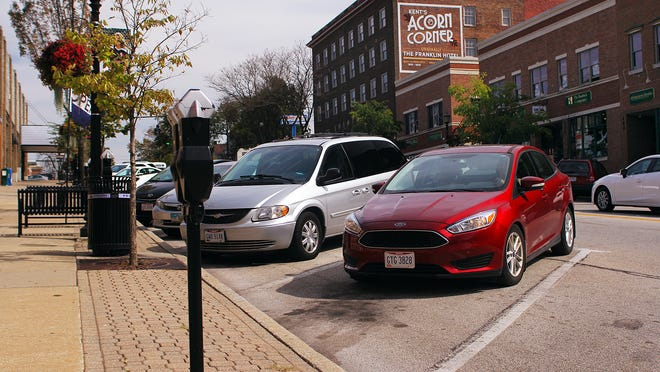 Kent will reactivate downtown parking meters starting June 15.