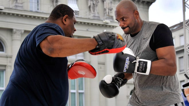 Tony Thompson, right, warming up with a trainer before his fight against Wladimir Klitschko in 2012. (Photo, Sebastien Feval, AFP/GettyImages)
