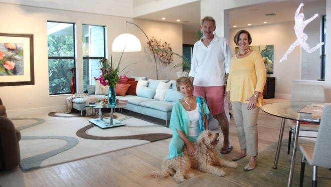 Homeowners Karen Semmelman (sitting with Labradoodle Chessy) and Bernie Ortwein in the great room of their Sanibel home, designed by area architect Joyce Owens (standing).