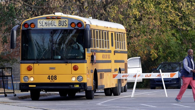 A school bus waits to leave Woodmore Elementary School on Tuesday, Nov. 22, 2016, in Chattanooga, Tenn. A school bus driven by Johnthony Walker, 24, crashed while transporting children home from the school Monday, killing at least five students. Walker was arrested Monday and charged with five counts of vehicular homicide including reckless driving and reckless endangerment, police said. (AP Photo/Mark Humphrey)