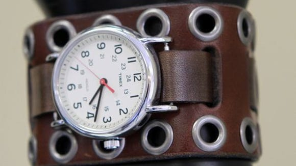 A handmade leather watch band made by Michael Burke.