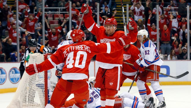 Red Wings defenseman Marek Zidlicky, facing camera, celebrates his goal in overtime against the New York Rangers with Henrik Zetterberg (40) during an NHL hockey game in Detroit on Wednesday, March 4, 2015. Detroit won 2-1.