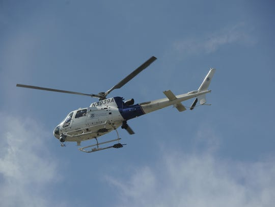 A Customs and Border Protection helicopter searches