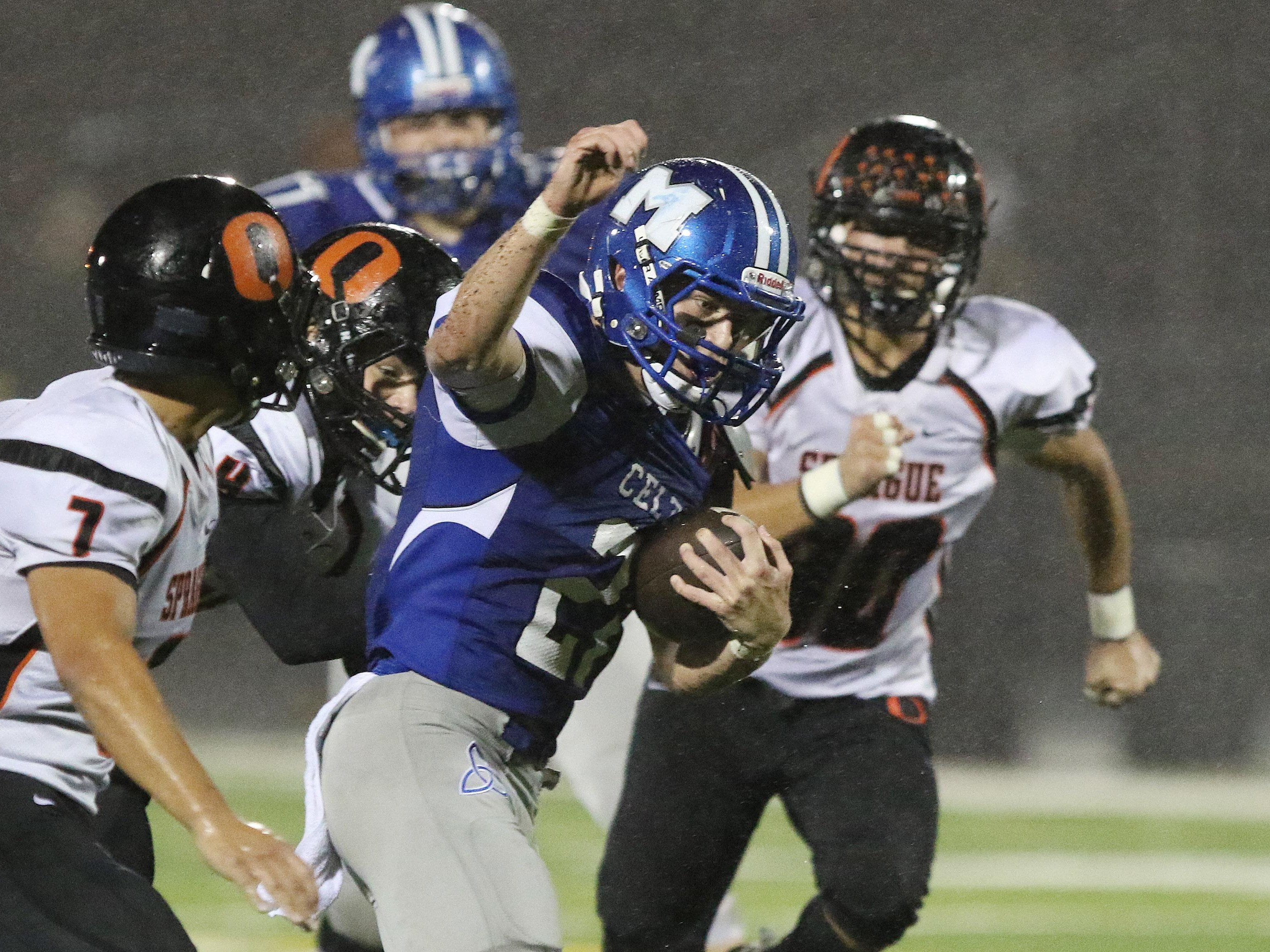 Sprague defenders surround McNary's Brady Sparks in a Greater Valley Conference game Friday, Oct. 30, 2015.