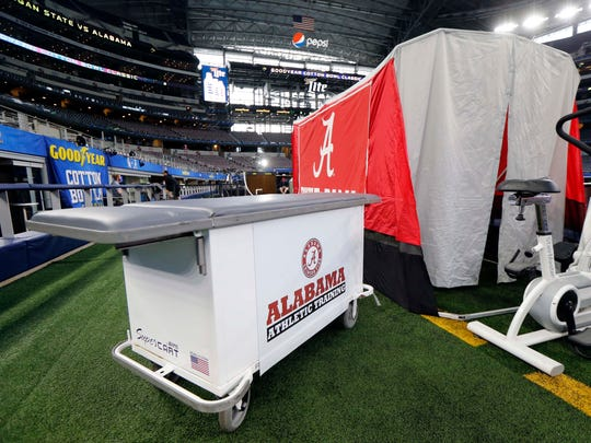 A mobile trainer's examination table sits outside the